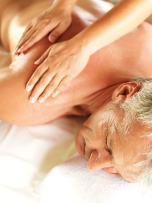 Closeup of mature man receiving a relaxing back massage at spa
